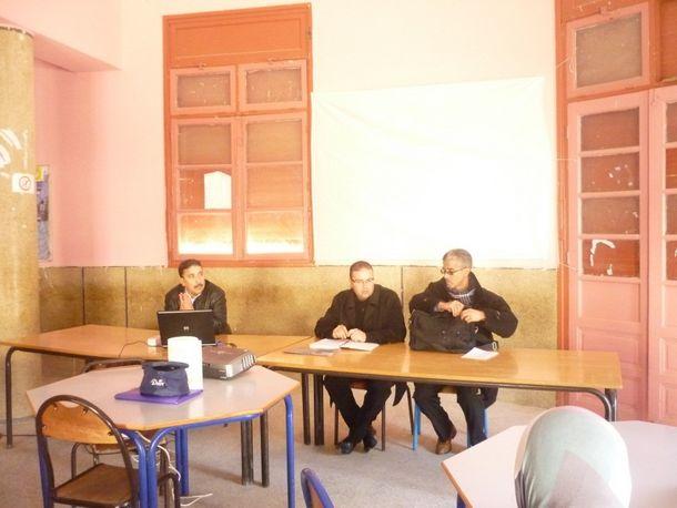 الأستاذ أمين  الغزاوي (يسار الصورة)